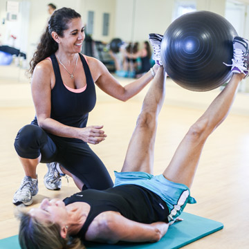 Instructor with fitness ball
